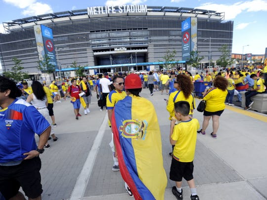 Ecuador fans wear flags and jerseys walking into MetLife Stadium for the Copa America match between Ecuador and Haiti in East Rutherford on Sunday, June 12, 2016.