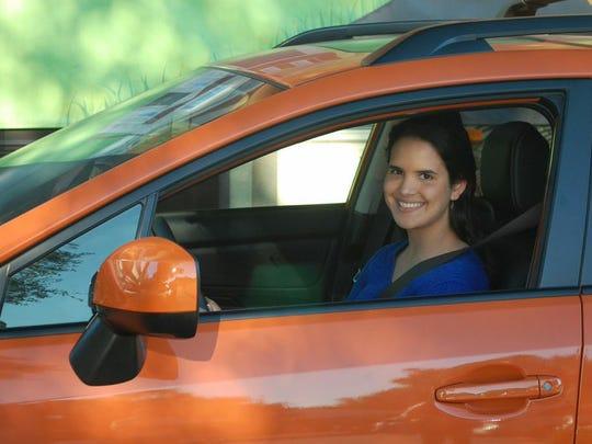 Grand prize winner Claudia Corcho, in her new Subaru