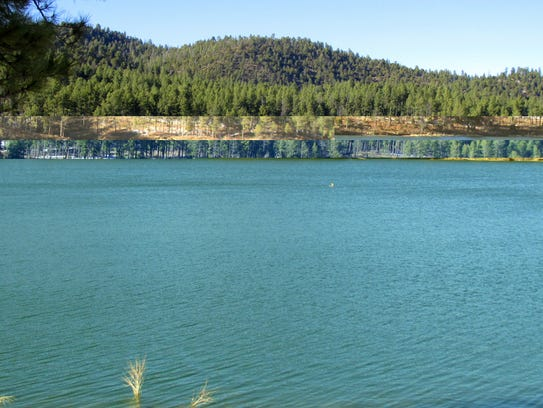 A mere spot on the blue surface of Mescalero Lake,