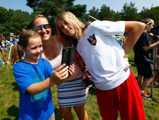 From left, Alexa, Sara, and Aydan Kemp of Owego take