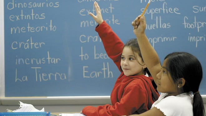 In a photo taken in 2004, second graders in the dual language immersion program at Sunny Sands Elementary School raise their hands during class. Palm Springs Unified School District will relaunch its dual language immersion program this fall.