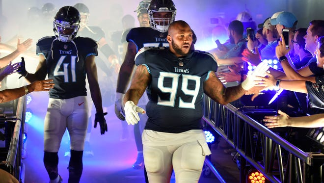 Titans defensive tackle Jurrell Casey (99) and teammates slap hands with fans before a preseason game against Tampa Bay at Nissan Stadium Saturday, Aug. 18, 2018, in Nashville, Tenn.