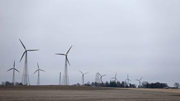 Branstad backs Iowa wind energy, defends Trump on coal