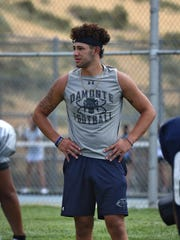 Damonte's Richie Garcia runs through plays during practice