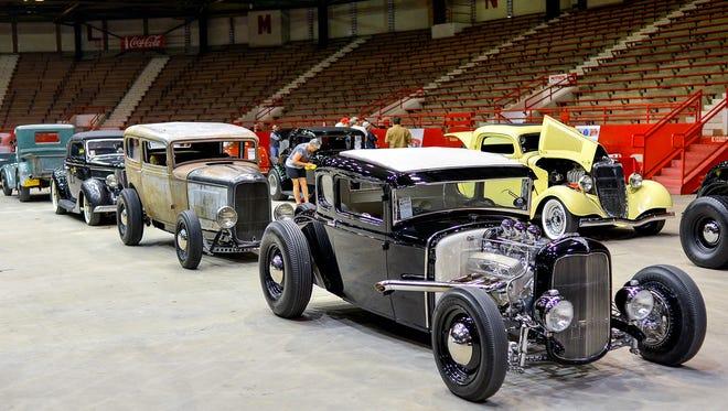 Vintage vehicles are on display inside Blackham Coliseum during the 2015 Bayou Round Up.