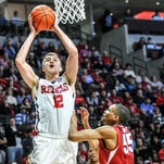 Ole Miss forward Tomasz Gielo (12) shoots against Arkansas forward Keaton Miles (55) on Saturday during their game in Oxford.