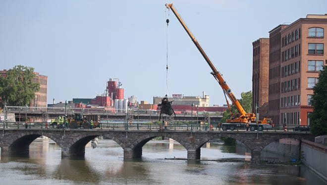 City Department of Environmental Services crews cleaned debris from the Genesee River Saturday, June 30, 2018.