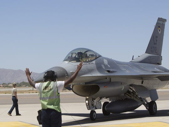 In a 2011 file photo, ground crew inspect an F-16 that recently landed at Luke Air Force Base in Glendale after a training exercise.