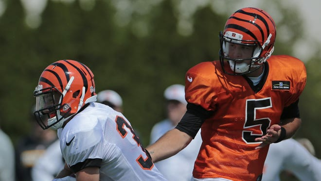 Quarterback AJ McCarron, right, has had an uneven first week of camp for the Bengals.