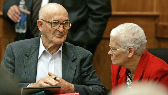 In this June 20, 2005 photograph, Edgar Ray Killen confers with his wife Betty Jo Killen, in Philadelphia, during a recess of his murder trial for the 1964 slayings of three civil rights workers.