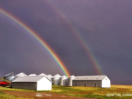A double rainbow appeared over his grain bins as a Choteau farmer returned from seeding his fields in May