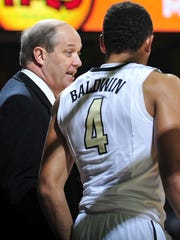 Vanderbilt coach Kevin Stallings and point guard Wade