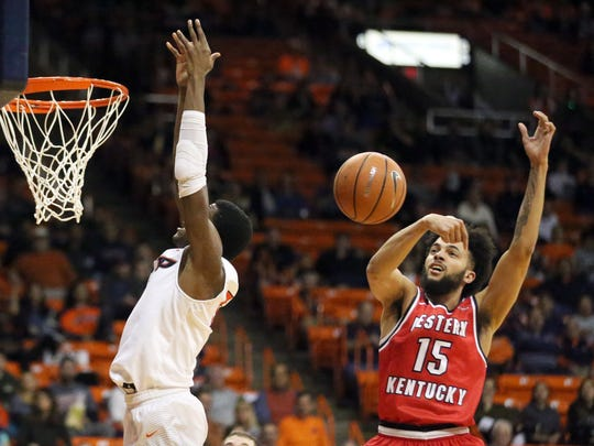 UTEP's Trey Wade gets the ball stripped by Western Kentucky's Darius Thompson, 25, while going for a dunk Thursday night in the Don Haskins Center.