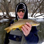Kyzystof Drozd with a nice brown trout in Richland County