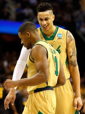 Zach Auguste and Demetrius Jackson celebrate Notre Dame's impressive second half Thursday vs. Wichita State.