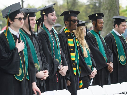 Students stand at the conclusions of the University of Vermont graduation ceremony on Sunday morning May 20, 2018 in Burlington.