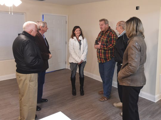 Members of the Mountain Home City Council talk with Freedom's Landing manager Tina Gummalauski on Thursday evening after walking through one of the apartments on the property.