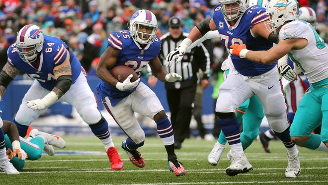 Bills running back LeSean McCoy follows his blockers against the Dolphins.  McCoy rushed for 50-yards and had two touchdowns.