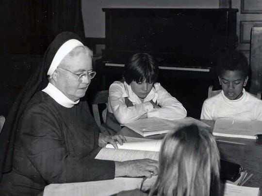 A member of the Sisters of Mercy working with students.