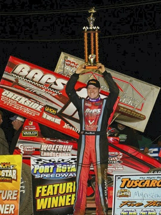 Brent Myers hoists the trophy after capturing the Night Before the Tuscarora 50 on Friday at Port Royal. The Sprint driver also won the main event, the Tuscarora 50, on Sunday.