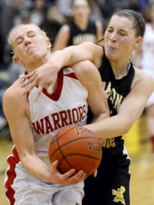Delone Catholic's Maddie Comly, right, tries to stop Susquehannock's Shannon Druck causing a foul during Friday's YAIAA girls' basketball tournament quarterfinal at Central York High School. Druck scored 19 points to help Susquehannock win, 72-47. (Kate Penn -- GameTimePA.com)