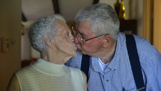 Virginia Parker, 79, and her husband Jim Parker, 81, who have been married for 61 years, share a kiss Sunday after she got her singing valentine.