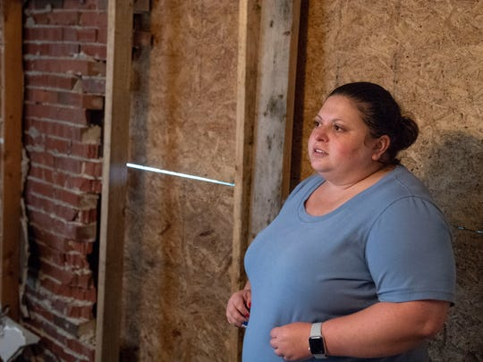 In this file photo from July 5, 2018, Jennifer Smith stands next to a wall that was destroyed when a man who had been fleeing from the police lost control of his car and crashed into her home in Manchester Township. She's since reached out to the man, Kameron Smith, no relation, and showed mercy toward him.