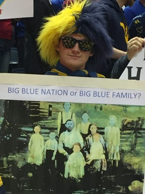 A West Virginia fan displays a sign made for ESPN's College GameDay before a game against Kentucky.