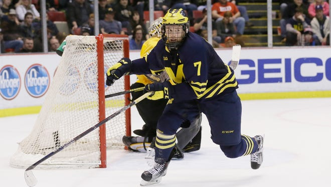 Michigan forward JT Compher (7) skates during the third period of U-M's 4-2 win in the Great Lakes Invitational championship game Wednesday at Joe Louis Arena.