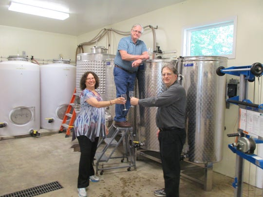 Anna Marie Bowers (left) and Don Bowers (right) are the new owners of Kinkead Ridge Winery. Ron Barrett is in the middle.