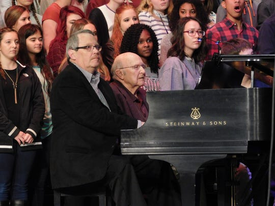 "Former directors of the Chambersburg Area Senior High School Glee Club, Robert Eyer (1998-2012) and Ferree LeFevre (1969-1998) provide piano accompaniment while the Glee Club sings the ""Hallelujah"" chorus at a dress rehearsal on Friday, Dec. 15, 2017. The former directors will perform the piece with the Glee Club during the annual Christmas show on Monday (Dec. 18) and Tuesday (Dec. 19) evenings in celebration of the club's 75th anniversary."