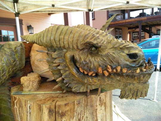 The re-grand opening of Oregon 3D Art and Chainsaw Sculptures features art, live carving, demonstrations, a raffle on Sunday, and a free BBQ.