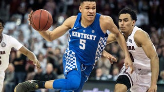 FILE - In this Jan. 16, 2018, file photo, Kentucky forward Kevin Knox (5) dribbles the ball against South Carolina forward Justin Minaya (10) during the first half of an NCAA college basketball game in Columbia, S.C. Knox is a possible pick in Thursday's NBA Draft.(AP Photo/Sean Rayford, File)