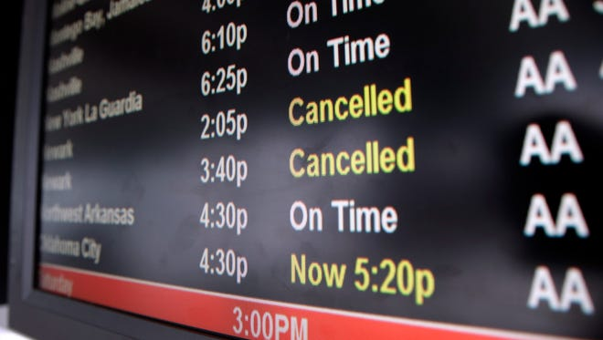 A screen displays flight status information at O'Hare International Airport in Chicago on Feb. 1, 2014.