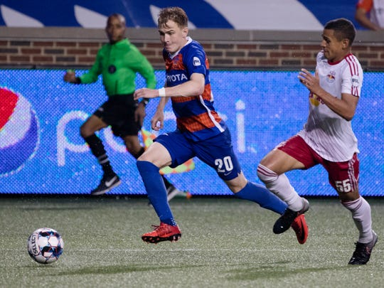 FC Cincinnati midfielder Jimmy McLaughlin (20) runs by New York Red Bulls II midfielder Steven Echevarria (55) during the USL soccer match between New York Red Bulls II and FC Cincinnati at Nippert Stadium in Cincinnati on Saturday, July 21, 2018.