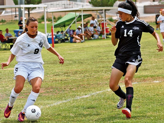 Genevieve Telles, left, tries to get past Chaparral's Isabel Gamboa on Saturday at the Riner Steinoff Soccerplex.