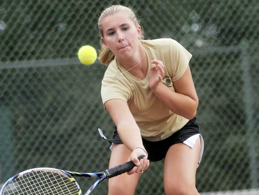 Delone Catholic's Alyssa Neudecker returns a shot during her 6-0, 6-0 victory against Susquehannock's Kristin Endres on Monday. The Squirettes won, 7-0.