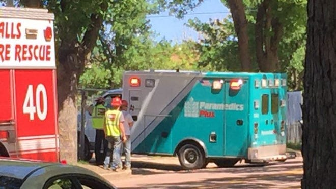 An ambulance leaves a construction site near 22nd Street and Grange Avenue on Monday, June 6, 2016.