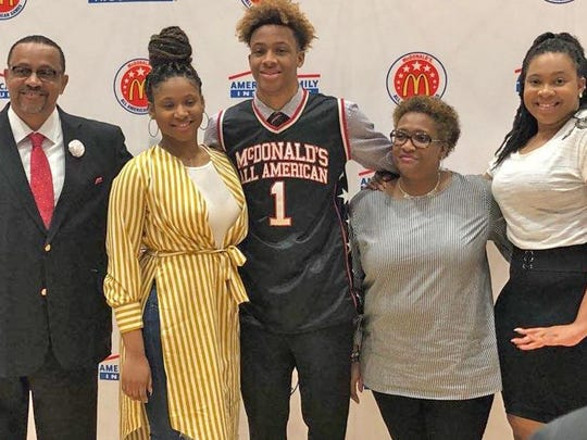 The Langford family poses with Romeo in his McDonalds All American gear.