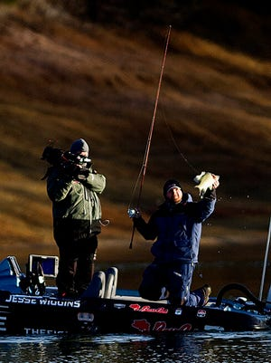 Jesse Wiggins catches a bass during the second day of the Bassmaster Elite Series Tournament on Friday at Cherokee Lake in Jefferson County.