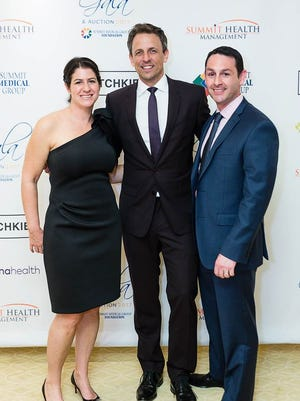 "Summit Medical Group Foundation took in $1.1 million at its annual fundraising gala and auction. Pictured are guest host of the event, Seth Meyers of NBC's ""Late Night with Seth Meyers,"" flanked by Rebecca Levy, Esq., Foundation vice president, and her husband, Derek Levy."