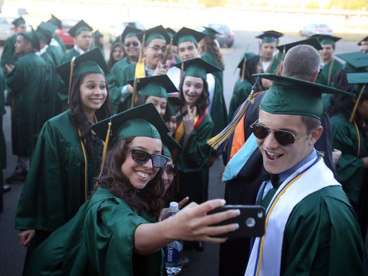 McKay graduates of the class of 2014 attend their graduation at The Pavilion Friday June 6, 2014.