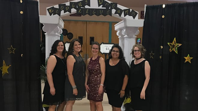 Kathy Roush, Amber Carroll, Lisa Fisher, Alicia McMurry and Tracy Gorby organized the Keeping the Dreams Alive Gala to celebrate Alamogordo Public Schools staff.