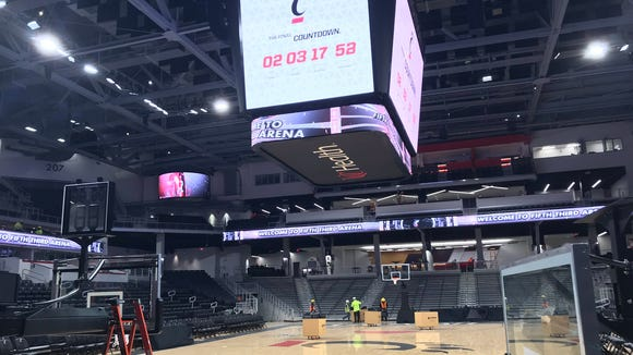 Workers put the final touches on the $87 million renovation of Fifth Third Arena.