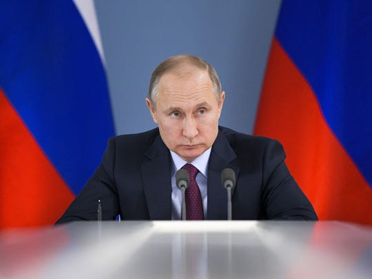 Russian President Vladimir Putin attends a meeting