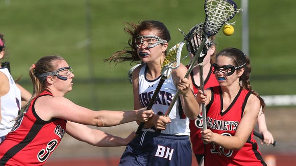 Rye's Margaret Mitchell (36) and Shannon Lavelle (18) knock the ball away from Byram Hills' Kyra Aronne (10) during girls lacrosse action at Byram Hills High School in Armonk May 10, 2018. Rye won the game 13-12.