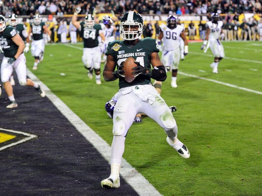 Le'Veon Bell scores a touchdown in MSU's 17-16 win over TCU in the Buffalo Wild Wings Bowl  on Dec. 29, 2012.