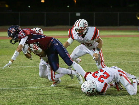 Christian Sanchez  stopped by 3 Palm Springs defender.