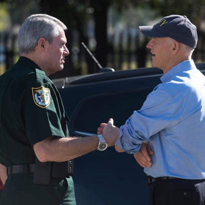 Escambia County Sheriff David Morgan, left, speaks