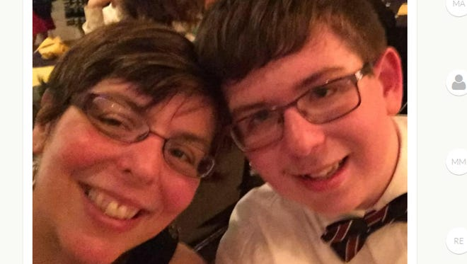 A screenshot of a GoFundMe campaign shows Michael Lynch, 14, and his mother, Bernadette. Michael was critically injured when he was struck by a car on Cooper Road in Irondequoit late last month.